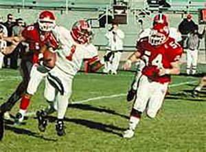 2001_12_01 Keith Ennis races past CV Matt Andrechil and Tim Cook