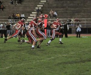 team_protects_ball_carrier